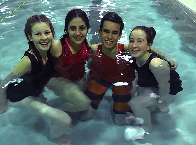 An image of a happy gang of swim instructors at back to basics swim academy inc.