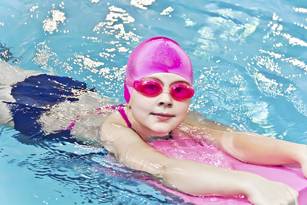 An image of a young girl learning how to swim at back to basics swim academy inc.